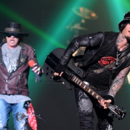 "LAS VEGAS, NV - MAY 21:  Singer Axl Rose (L) and guitarist Dj Ashba of Guns N' Roses perform at The Joint inside the Hard Rock Hotel & Casino during the opening night of the band's second residency, ""Guns N' Roses - An Evening of Destruction. No Trickery!"" on May 21, 2014 in Las Vegas, Nevada.  (Photo by Ethan Miller/Getty Images)"