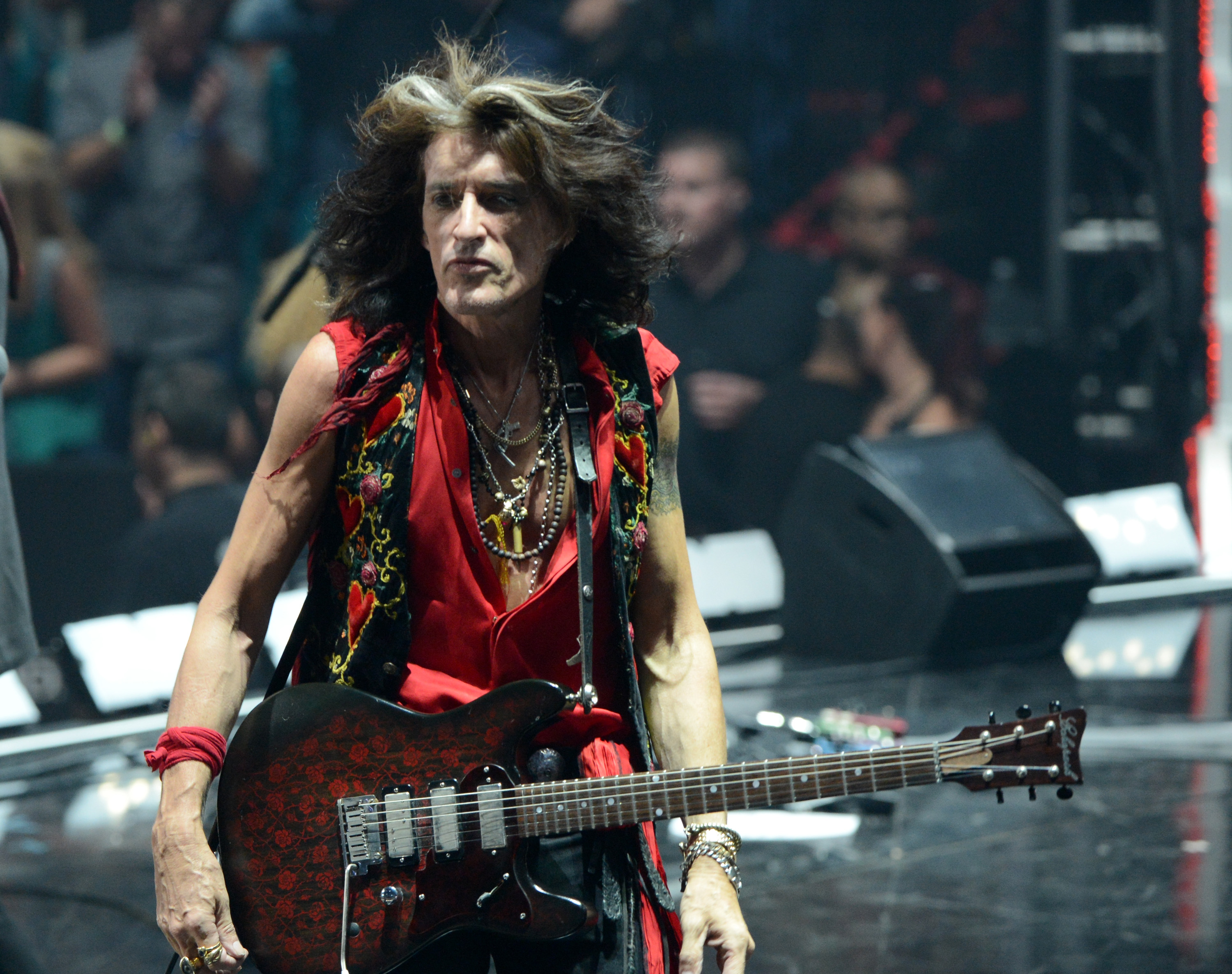 LAS VEGAS, NV - SEPTEMBER 22:  Guitarist Joe Perry of Aerosmith performs onstage during the 2012 iHeartRadio Music Festival at the MGM Grand Garden Arena on September 22, 2012 in Las Vegas, Nevada.  (Photo by Michael Kovac/Getty Images for Clear Channel)